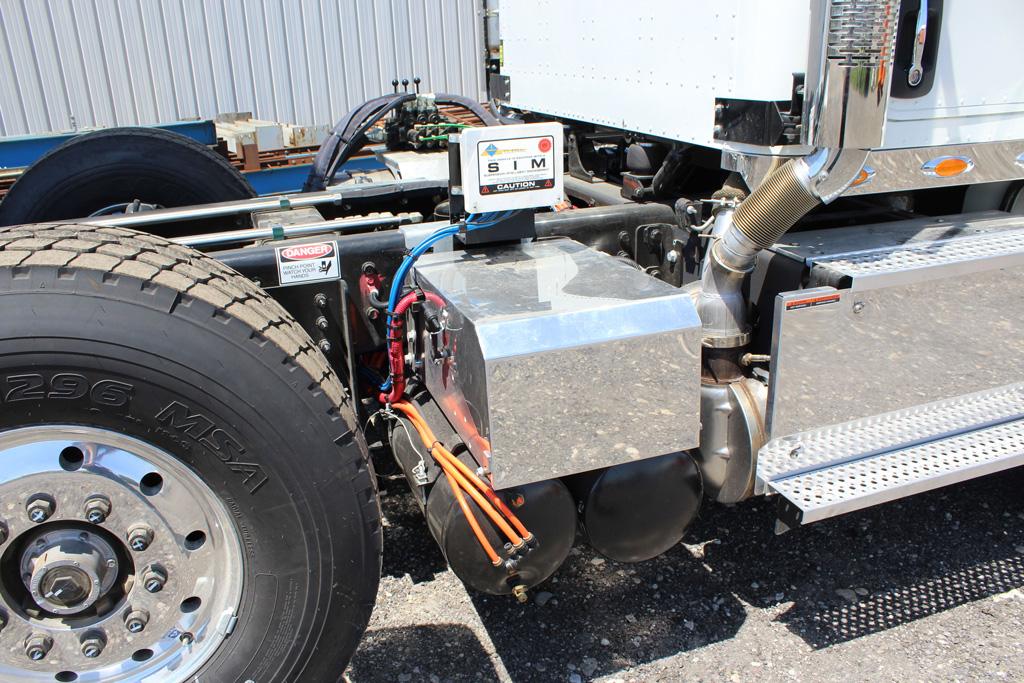 Tri-axle-On-Trux-rolloff-or-roll-off-system-galvanized-International-HX-(16)