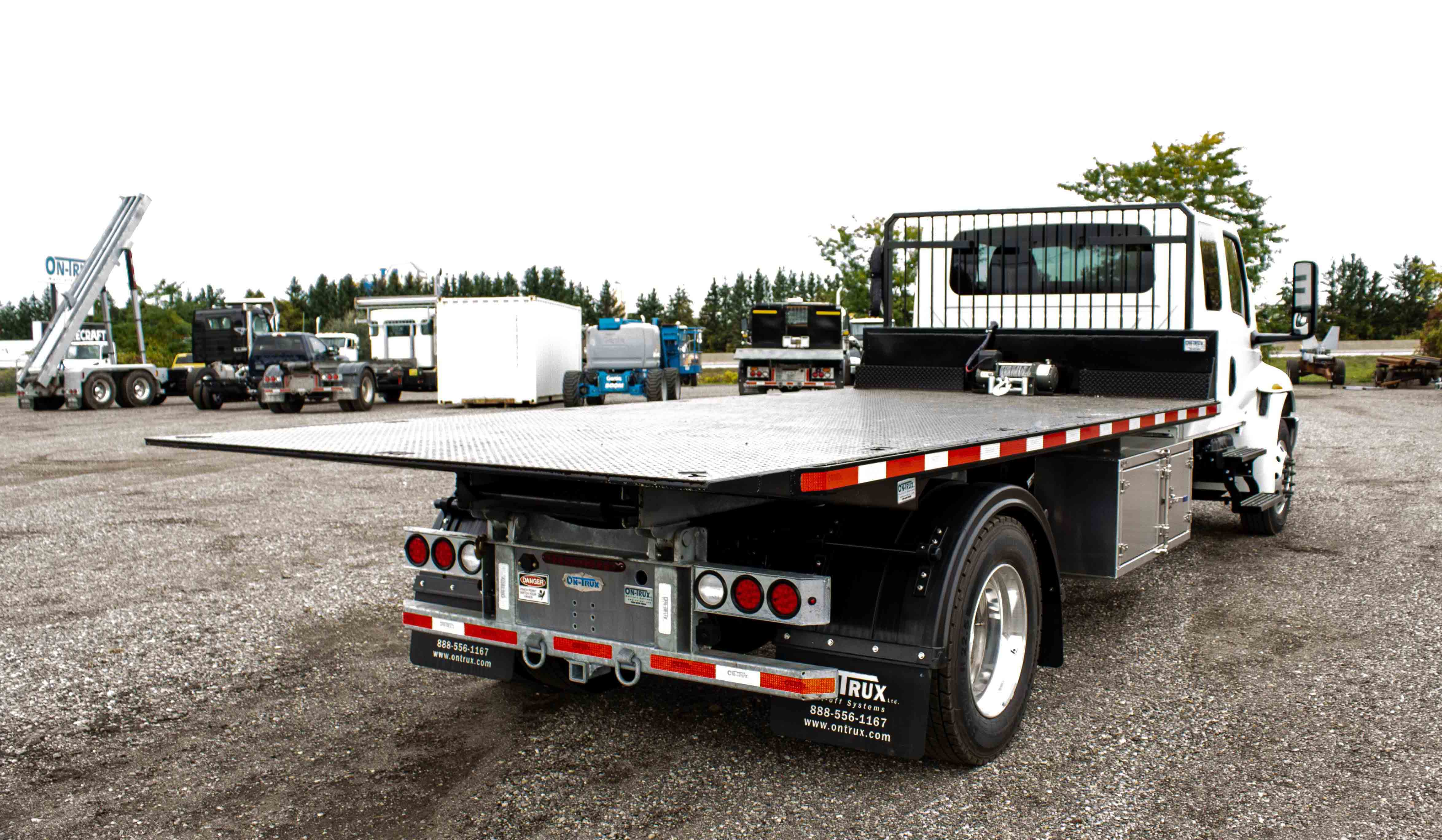 SINGLE AXLE ON TRUX ROLL OFF SYSTEM INTERNATIONAL MV EXTENDED CAB (10)