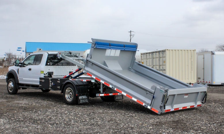 LANDSCAPE DECK ROLL OFF AND HOOK LIFT ON TRUX (15)