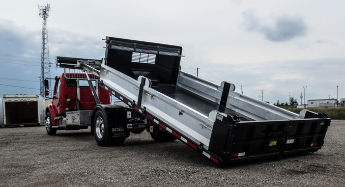 LANDSCAPE DECK ROLL OFF AND HOOK LIFT ON TRUX (2)