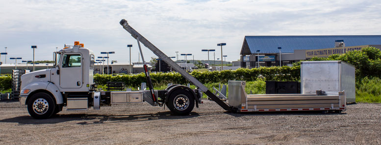 LANDSCAPE DECK ROLL OFF AND HOOK LIFT ON TRUX (29)