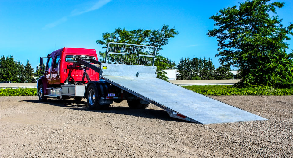 ON TRUX FLAT DECK ROLL OFF AND HOOK LIFT (1)