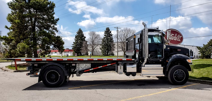 PETERBILT 357 ON TRUX ROLL OFF SYSTEM (3)
