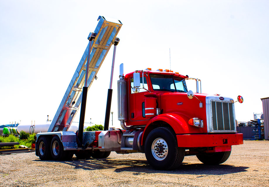 PETERBILT 357 TANDEM ON TRUX ROLL OFF SYSTEM (10)