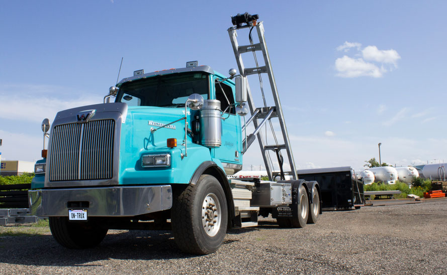 WESTERN STAR TANDEM CUSTOM ON TRUX ROLL OFF SYSTEM (1)